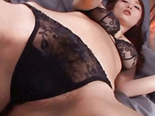Asian lingerie babe shows off her big tits and hairy vagina
