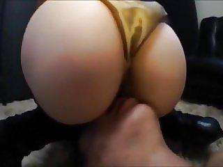 Asian in gold satin panties face sitting